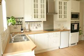 Kitchen With Cream Cabinets by How To Tile Bathrooms Or Kitchens Using Metro Or Subway Tiles