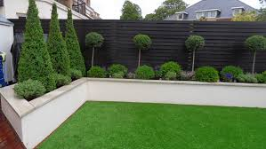 garden wall rendered wall but without capping note colour of wooden fence too