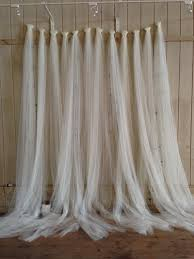 tulle backdrop i can order rolls of tulle and hang lights it 10 7 17