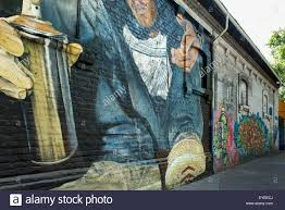 spray paint wall art shenra com mural of a graffiti artist with a can of spray paint painted on a
