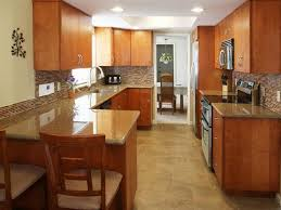 galley style kitchen design with white cabinets and wall paint