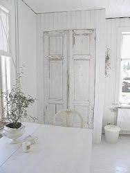 the decorative genius of repurposing places in the home this link has a beautiful door made from a repurposed armoire the