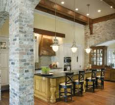 exposed brick kitchen backsplash brown wooden pedestal countertop