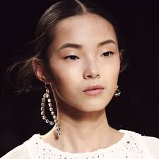 mismatched earrings mismatched earrings 2016 fall trend alert the fashion tag