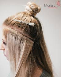 what is the best tap in hair extensions brand names how to place tape hair extensions when creating a top knot bun or