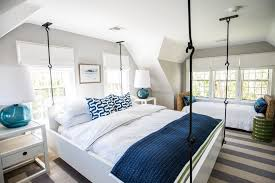 navy and white bedroom beach style with green side table