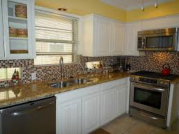 white kitchen cabinets with backsplash white french country