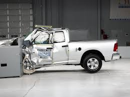 crashed white jeep 2016 ram 1500 extended cab driver side small overlap iihs crash