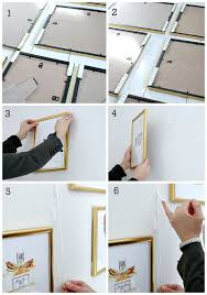 how to hang without nails hanging pictures without nails simply simple hanging wall art