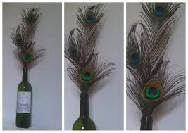 peacock feather centerpieces and vintage inspired placesettings