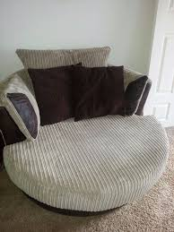 dfs crompton brown cord swivel cuddle chair in timsbury