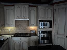 marble countertops stained kitchen cabinets lighting flooring