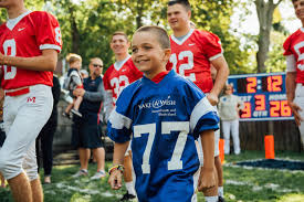 rob gronkowski grants boy u0027s make a wish for backyard football night