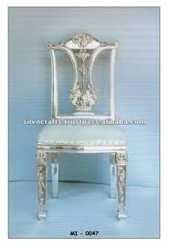 royal carved silver dining table and dining chair set silver