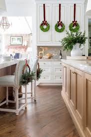 top of kitchen cabinet greenery 5 top picks for wreaths on kitchen cabinets bluegraygal