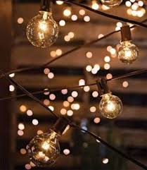 Patio String Lights by How To Plan And Hang Patio Lights Patio Lighting Pergolas And