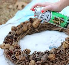 Glitter Spray For Christmas Decorations by Festive Diy Wreath Made From Pinecones And Greenery