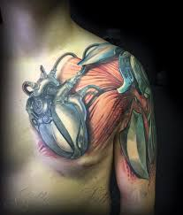 3d heart and muscles bio mechanical tattoo on chest tattoos