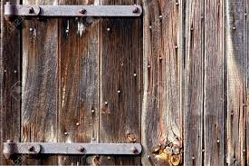 Rustic Barn Door Hinges by Weathered Old Wood Barn Door With Vintage Iron Hinges Stock Photo