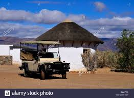 african jeep a safari jeep parked in front of an african style hut south