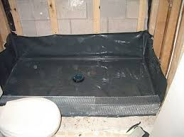 concrete shower pan packing and embedding mud into lath breaking