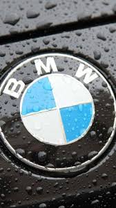 bmw logos the bmw logo on a black car with raindrops wallpaper download 720x1280