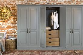 grey finishing built in wardrobe with wooden unfinished drawer for