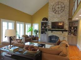 traditional living room with stone fireplace u0026 high ceiling in