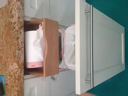 hidden drawer inside garbage drawer for the bags if you made