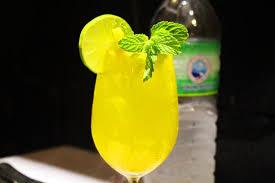 Mango Bomb mango bomb absolut vodka mango midori fruit and lime