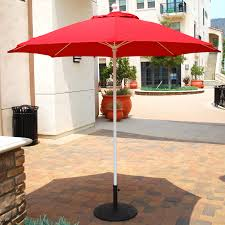 Pottery Barn Patio Umbrella by Patio Red Colored Patio Umbrella With Textile Canopy Over The