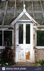 door of into an old decrepit victorian style greenhouse peeling