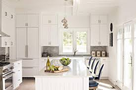 white beadboard kitchen island with blue vintage bar stools