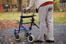 elder walker disabled elder person walking with walker stock photo picture and