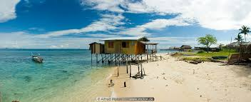 house on stilts and beach picture mabul sabah malaysia