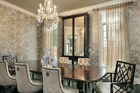 dining room in luxury home with gold walls stock photo picture