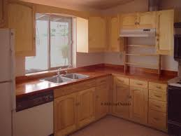 Dark Cherry Wood Kitchen Cabinets by Dark Brown Wooden Cherry Kitchen Cabinet With White Countertop