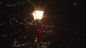 christmas lights that look like snow falling snow falling by lighted post lantern with christmas lights stock