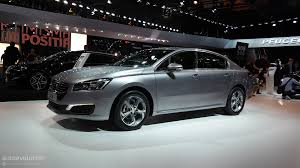 peugeot executive car peugeot 508 sedan sw and rxh updated for the paris motor show
