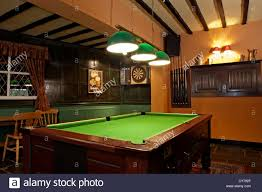 pubga e the sarah mansfield pub game room with pool table and darts stock
