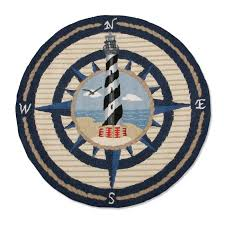 wool area rug with nautical compass rose and lighthouse design