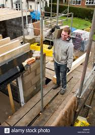 Building A Concrete Block House Self Building House Bricklayer Carrying Concrete Block On First