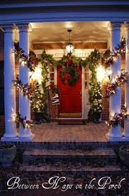 How To Decorate Banister With Garland 60 Beautifully Festive Ways To Decorate Your Porch For Christmas