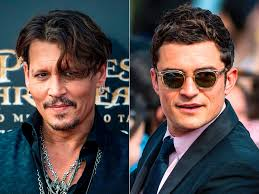 Bloom Johnny Depp And Orlando Bloom Reunite On Pirates Red Carpet