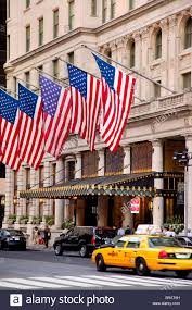 Flag Of New York City American Flags Fly Over Plaza Hotel Entrance In New York City Usa
