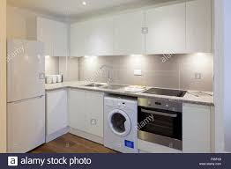 modern apartment kitchens one church square london uk an all white kitchen in a modern