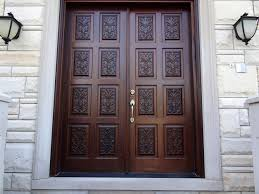 carved double doors design ideas with wooden materials and stone