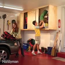 how to hang garage cabinets installing large garage cabinets the family handyman