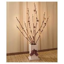lighted branches distressed wooden vase lighted branches lights berries