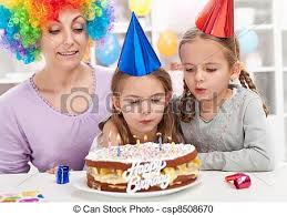 stock photography of birthday blowing out candles on a cake